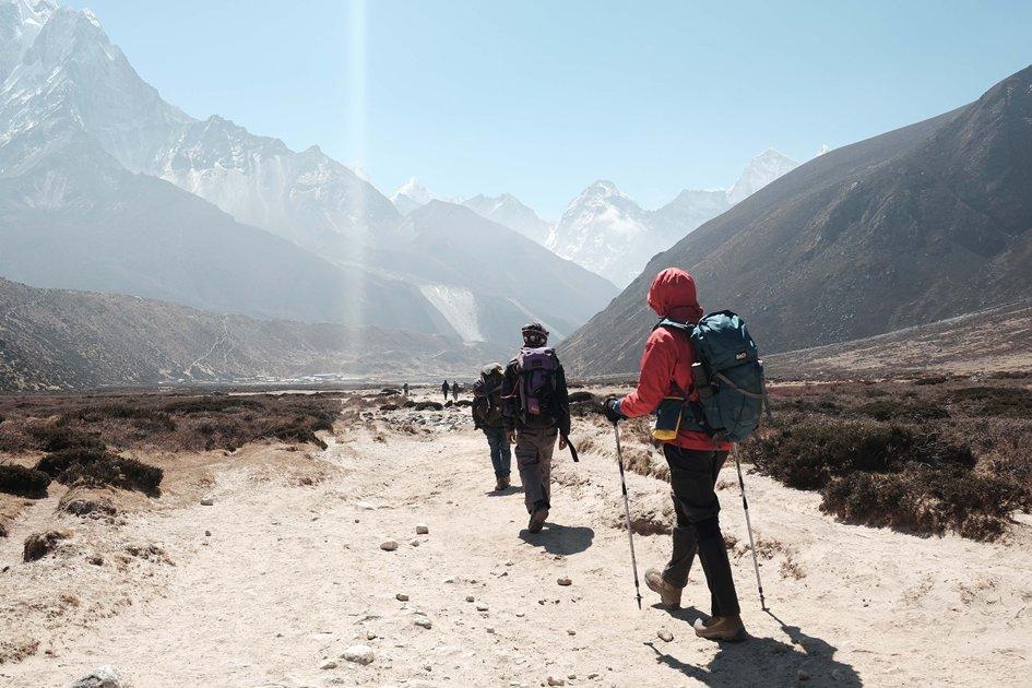 four men trekking in Himalayas